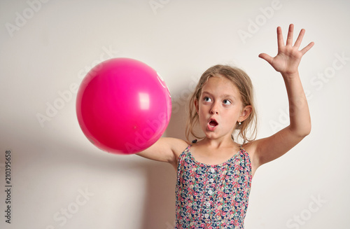 cheerful child with a red balloon