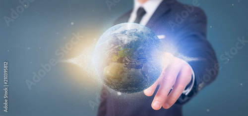 Businessman holding a 3d rendering particles earth globe - 210395812