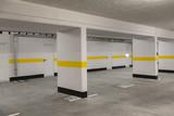 Typical underground car parking garage in a modern apartment house. - 210411090