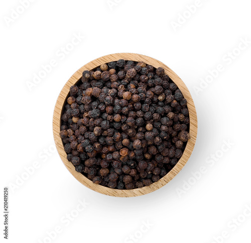 black peppercorns in wooden bowl isolated on white background - 210419250
