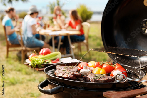 Modern grill with meat and vegetables outdoors, closeup - 210426297