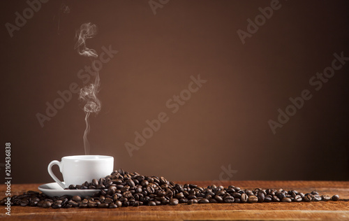 Fotobehang Koffiebonen Coffee on a brown background with copy space