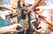 Leinwanddruck Bild - Friends group having addicted fun together using smartphones - Hands detail sharing content on social network with mobile smart phone - Technology concept with people millennials online with cellphone