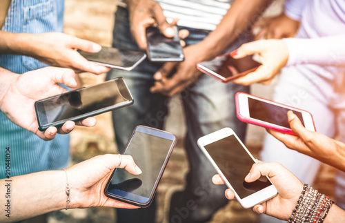 Leinwanddruck Bild Friends group having addicted fun together using smartphones - Hands detail sharing content on social network with mobile smart phone - Technology concept with people millennials online with cellphone