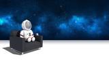 Astronauta sentado en sofá - 210447290