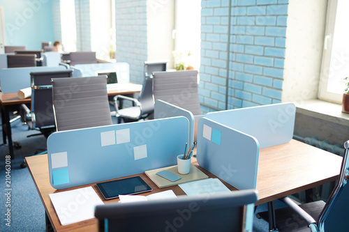 Several empty workplaces in open space office during coffee break or lunch break