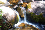 Sunset on a small stream and rocks in the Sangre De Cristo Mnts of Southern Colorado.