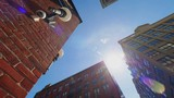 A low wide shot panning view looking up at red brick Brooklyn buildings. Shot at 60fps.   - 210486850