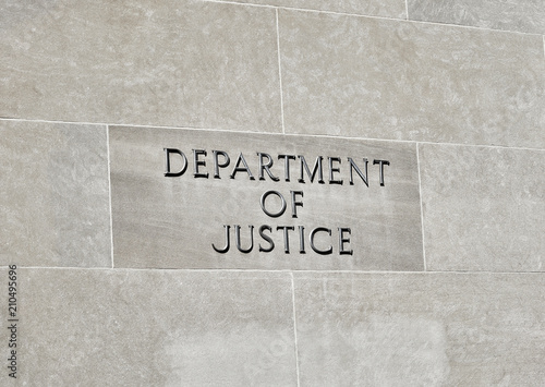Foto Murales Department of Justice sign on Building Wall