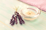 Aroma tea candle with lavender twigs on table, decor bokeh light, relaxing spa time. Toned. - 210509611