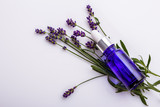 Lavender essential oil in a glass bottle with a pipette - 210515647