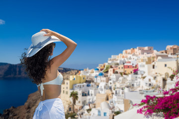Woman looking at the view in Santorini