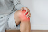 a man touching knee with red highlights concept of knee and joint pain - 210525219
