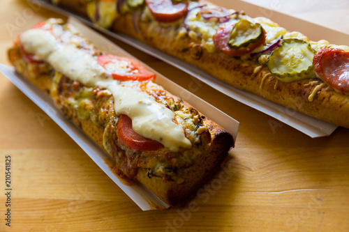 Wall mural Polish zapiekanka toasted baguette with cheese and vegetables
