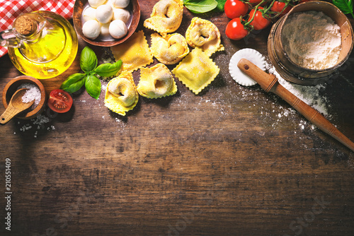 Top view on homemade pasta ravioli on old wooden table - 210551409