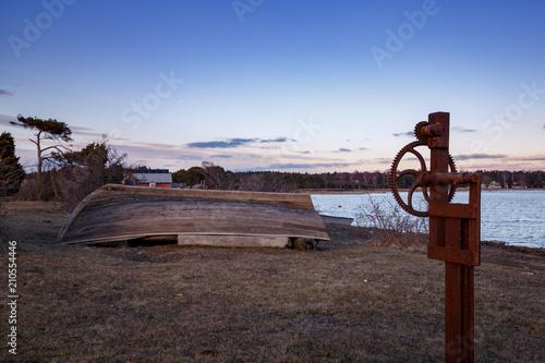 Fotobehang Bruin Old wooden boat on land