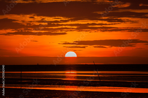 Fotobehang Bruin Colorful sky on beautiful beach at sunrise timing located at south of Thailand