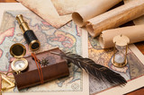 Planning a trip: quill pen, old rolled papers and maps with vintage items - 210562276