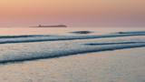 Beautiful colorful vibrant sunrise over low tide beach landscape peaceful scene - 210580241