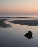 Beautiful colorful vibrant sunrise over low tide beach landscape peaceful scene - 210580243