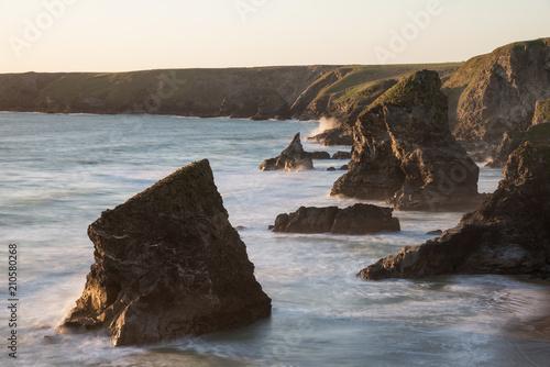 Aluminium Chocoladebruin Stunning dusk sunset landscape image of Bedruthan Steps on West Cornwall coast in England