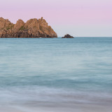 Stunning sunset landscape image of Porthcurno beach on South Cornwall coast in England - 210580643
