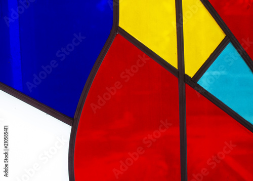 Cells of the coloured glass stained-glass windows of window.. - 210585411