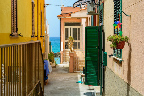 Fototapeta small street in town Pizzo leading to the sea, Calabria, Italy