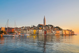 Colorful sunset of Rovinj town, Croatian fishing port on the west coast of the Istrian peninsula. Colorful evening seascape of Adriatic Sea. Traveling concept. - 210604441