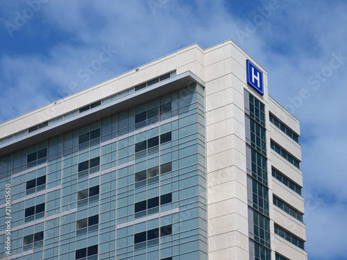 Foto Murales Building with large H sign for hospital