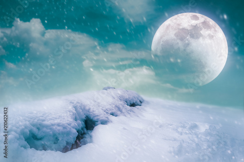 Fotobehang Groen blauw Landscape at snowfall with super moon. Serenity nature background.