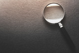 magnifying glass on  black texture  background. - 210629466