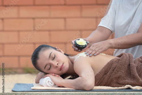 Young Beautiful Asian Woman Getting Massage In Spa Environment Traditional Oriental Aroma Therapy And Beauty