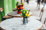 Flowers stand on a snowy table - 210635816