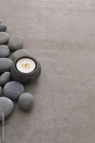 Aluminium Spa gray stones with candle and grey background