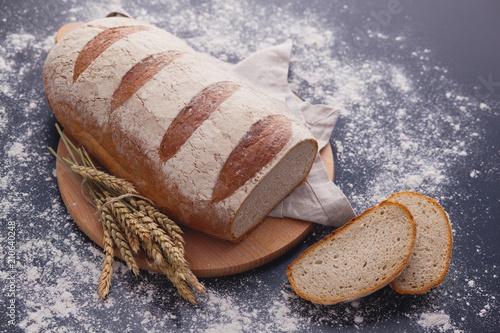 Fototapeta loaf of bread on black background