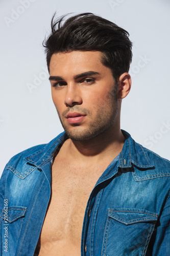 poortrait of sensual casual man with undone denishm shirt