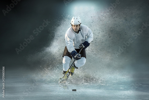 Leinwanddruck Bild Caucasian ice hockey Players in dynamic action in a professional