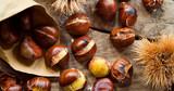 Roasted Sweet Chestnuts nuts on neutral wooden background closeup, macro, detail -  healthy seasonal snack. - 210672417
