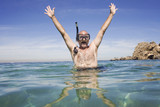 A mature man excited about Australian beach holiday. - 210674657