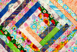 Cotton fabric folded in the shape of a square. View from above. Colorful cotton fabric for sewing clothes or bed linen.