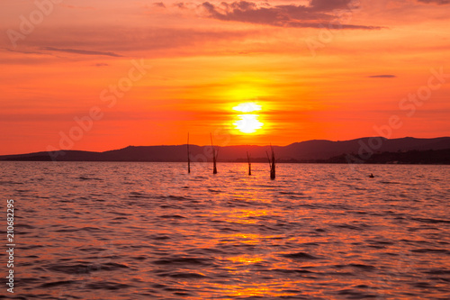 Plexiglas Koraal Scenery lake landscape with blue sky and sunset