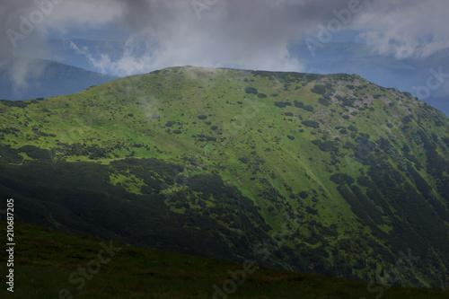Fotobehang Zomer Beautiful green mountains hills and cloudy blue sky