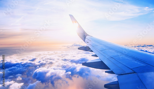 flying and traveling, view from airplane window on the wing on sunset time - 210716488