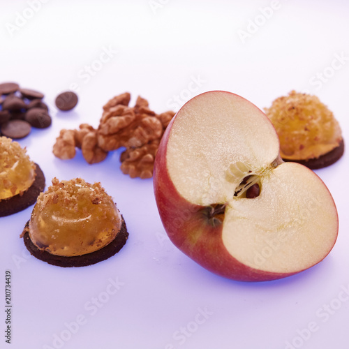 Fruit jelly with fresh apple. Healthy food. Apple jelly on chocolate with walnuts. Summer dessert with fruit jelly - 210734439