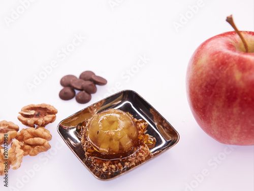 Fruit jelly with fresh apple. Healthy food. Apple jelly on chocolate with walnuts. Summer dessert with fruit jelly. - 210737058