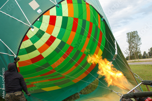 hot air balloon preparing for flight, heating air with fire