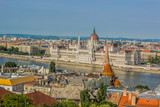 Budapest - capital of Hungary urban waterfront old medieval city district  from above in summer time colorful bright day with view on Danube river and house of parliament