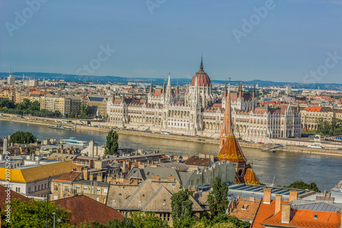 Budapest - capital of Hungary urban waterfront old medieval city district  from above in summer time colorful bright day with view on Danube river and house of parliament  - 210752679