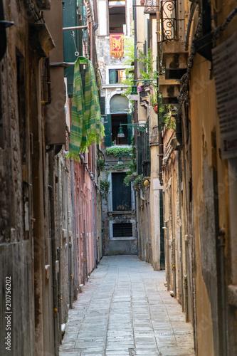 Fotobehang Smalle straatjes Narrow street in Venice Italy